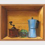 Un cafetière italienne, un bocal de café et un moulin à café.